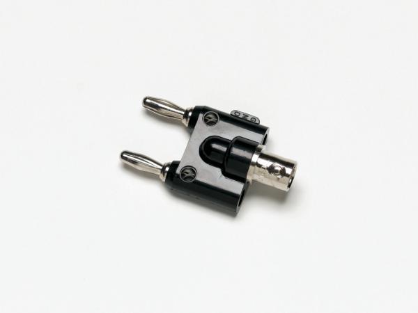 Adapteris iš BNC(F) į dvigubą pakopinį 4mm (banana) kištuką